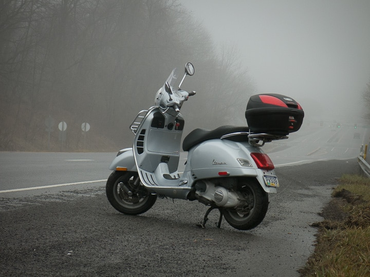 Vespa GTS scooter along foggy highway