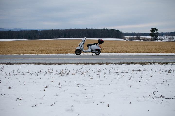 Vespa GTS scooter on a cold, snowy day.