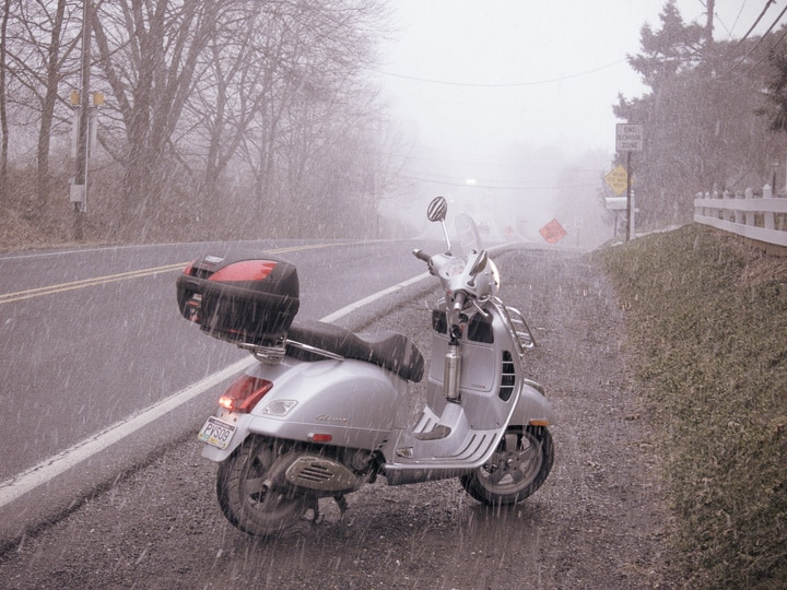 Vespa GTS scooter in snow squall