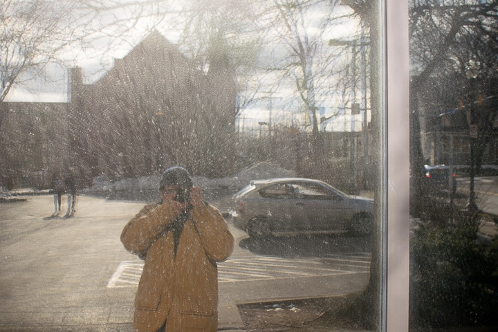 Reflection of Steve Williams in a window