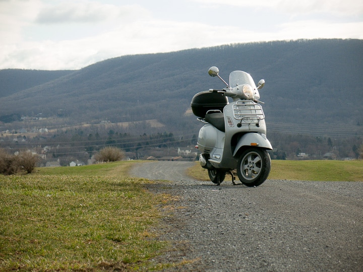 Vespa GTS scooter on a farm lane