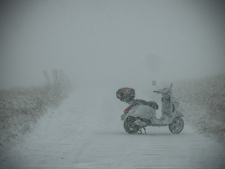 Vespa riding in a snow squall