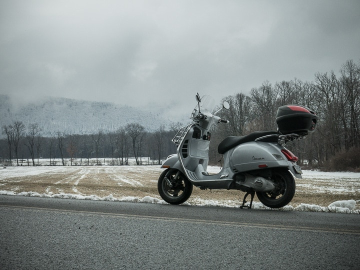 Vespa GTS scooter in a snow covered landscape