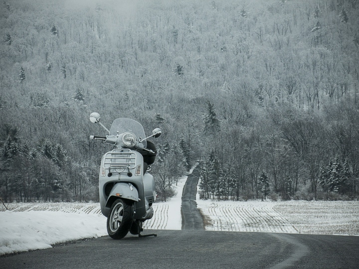 Vespa GTS scooter on a snowy winter ride