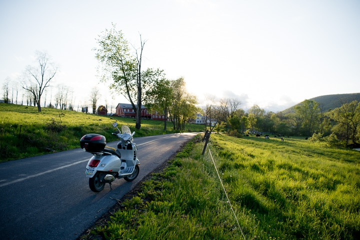 Vespa GTS scooter at sunset along a rural road