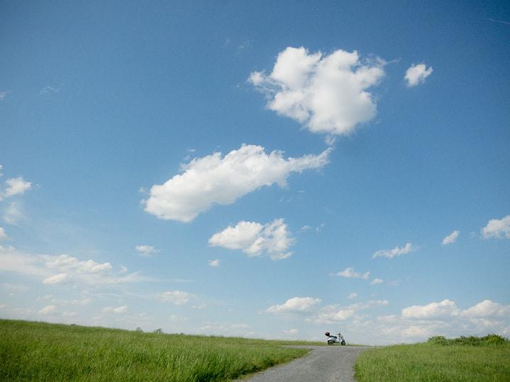 Vespa GTS under a blue sky.