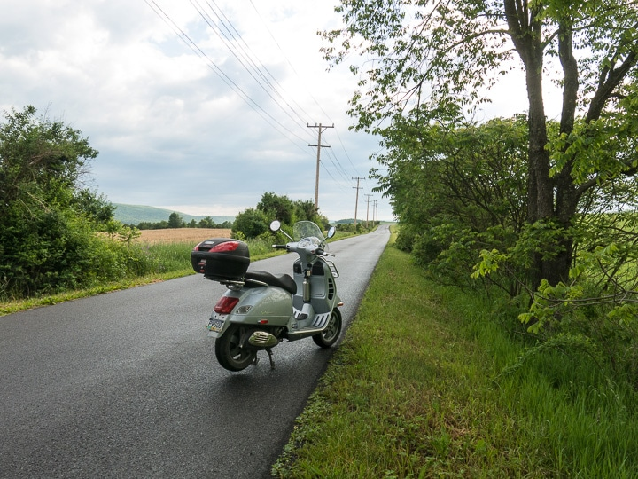 Vespa scooter on a wet rural road in Pennsylvania