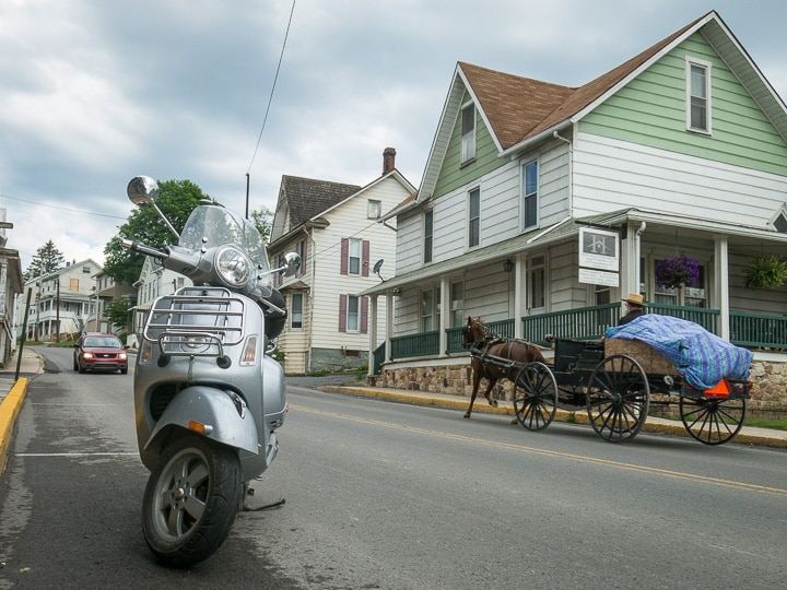 Vespa scooter and Amish Buggy