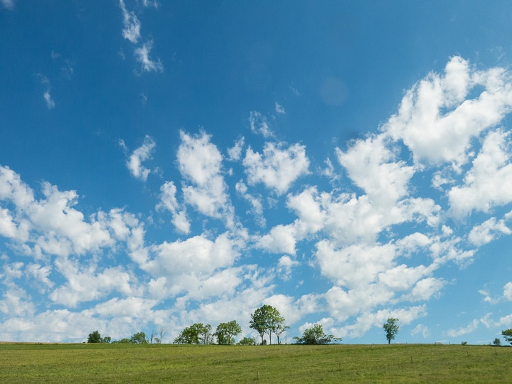 Blue sky and white clouds over a central Pennsylvania farm field