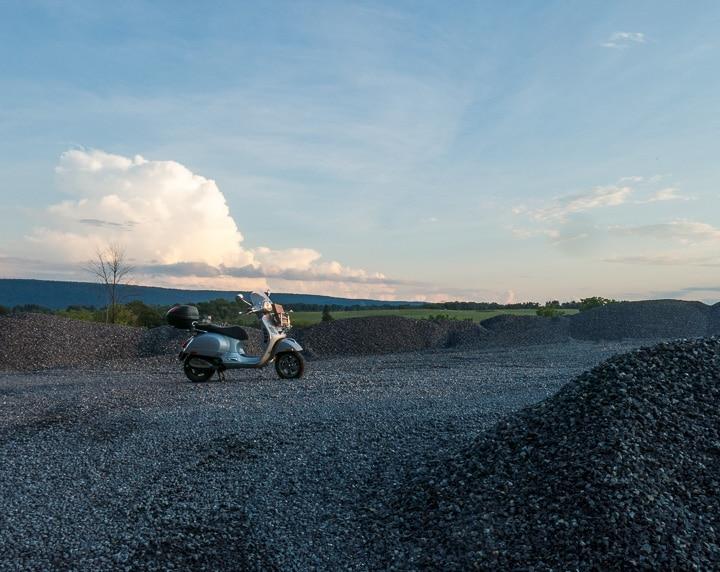 Vespa GTS scooter at sunset