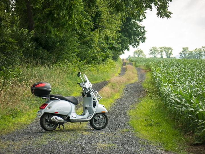 Vespa GTS scooter on a farm lane