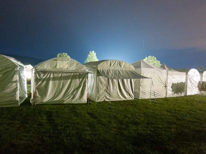 Artist tents at night at the People's Choice Festival in Boalsburg