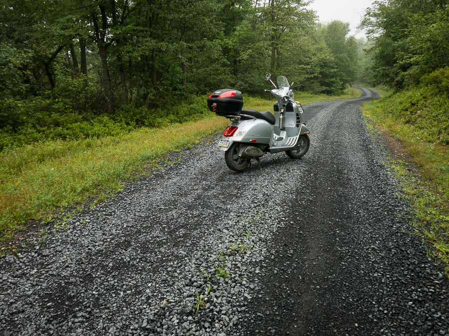 Vespa GTS scooter on gravel road in Rothrock State Forest