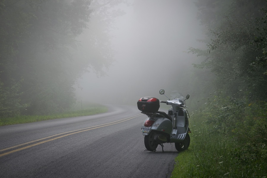 Vespa GTS scooter on a foggy morning Vespa ride