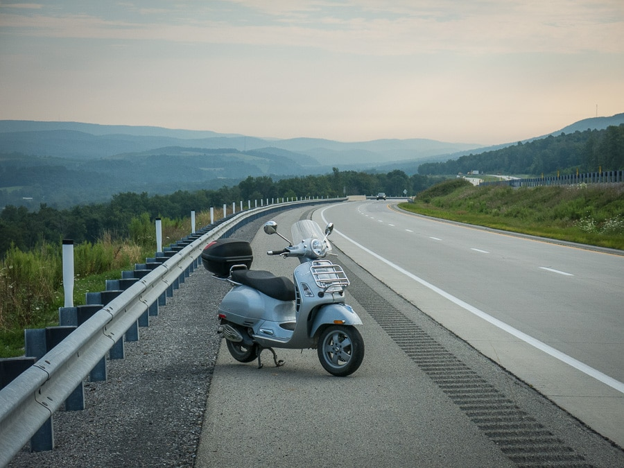 Vespa GTS scooter along Interstate 99
