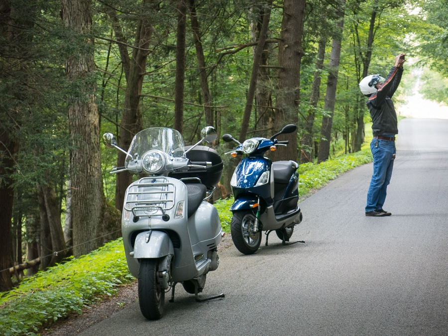 Vespa and Piaggio scooters on a forest road