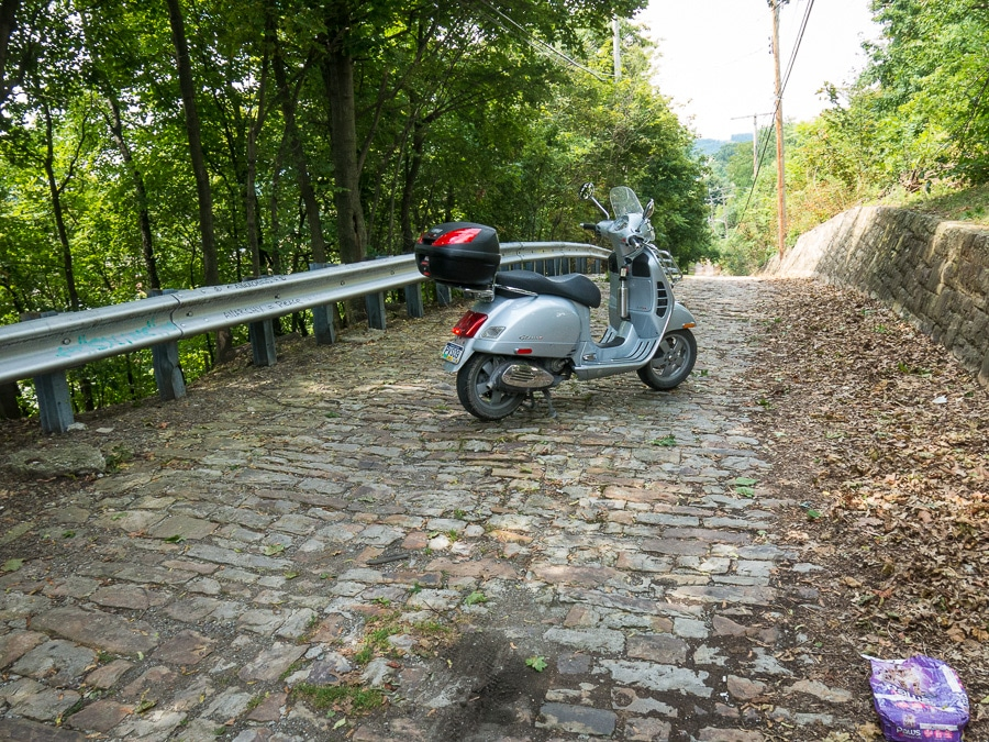 Vespa GTS scooter on cobblestone alley in Altoona, Pennsylvnaia