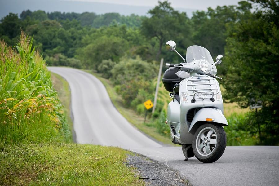 Vespa GTS scooter on quiet rural road