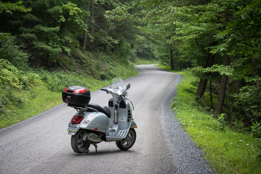 Vespa GTS scooter on a gravel road