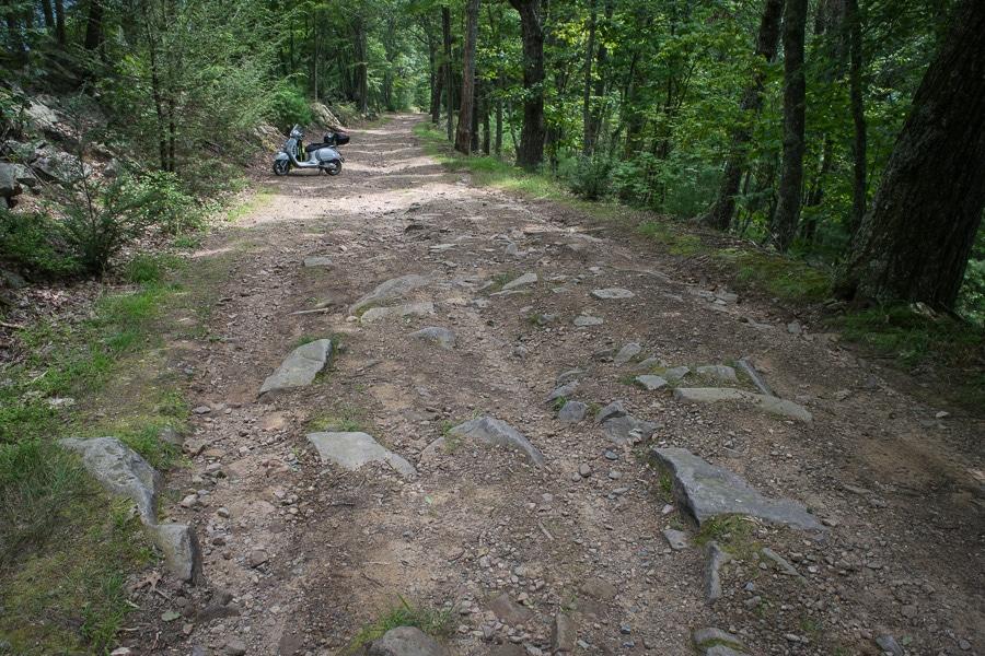 Vespa GTS scooter on rocky road