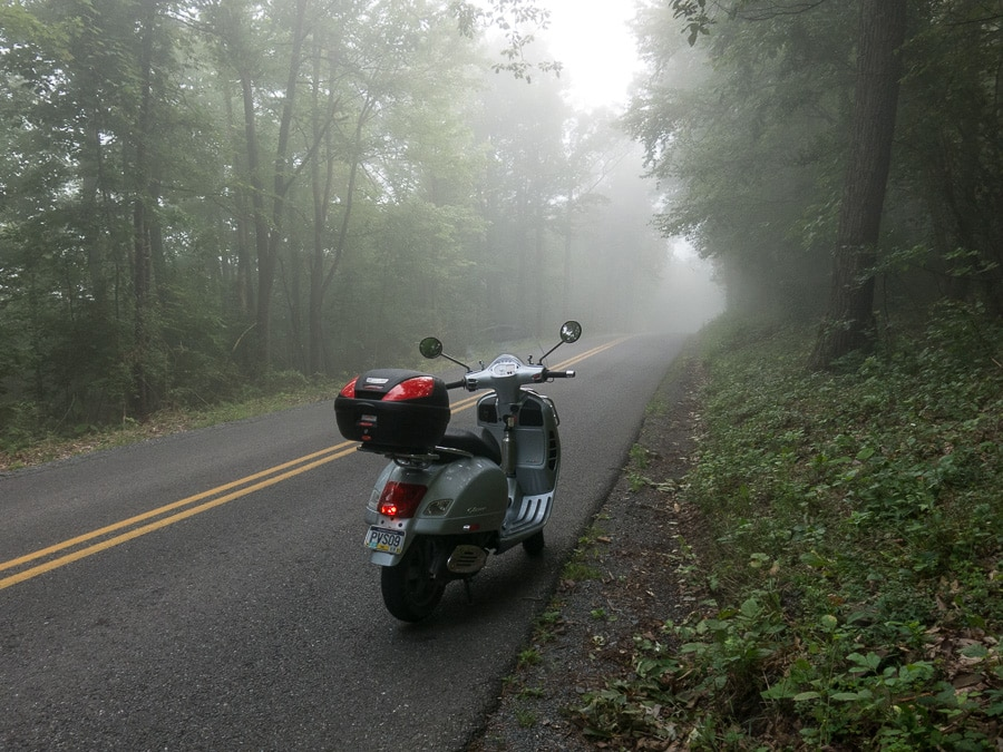 Vespa GTS scooter on a foggy road