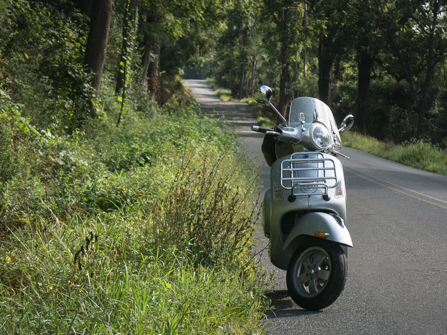 Vespa GTS scooter on a country road