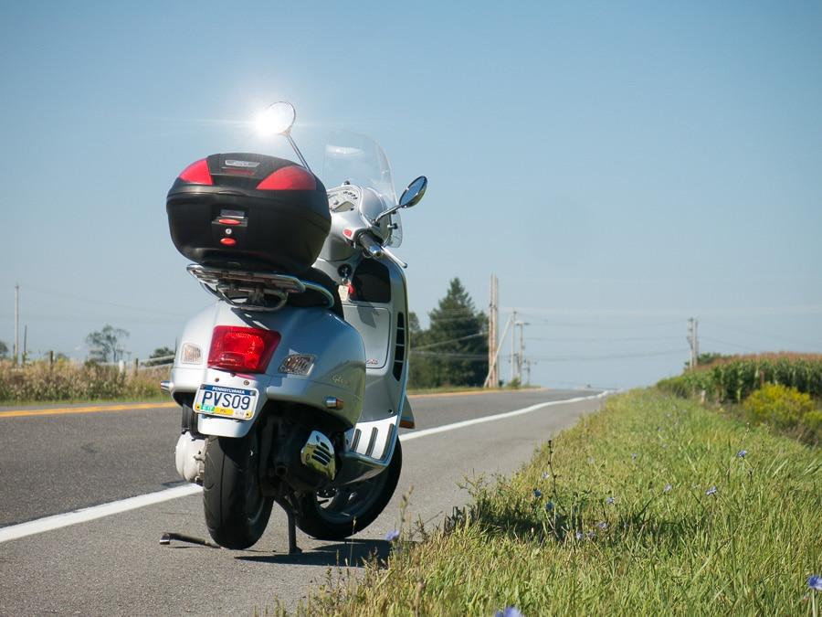 Vespa GTS scooter on a bright sunny day
