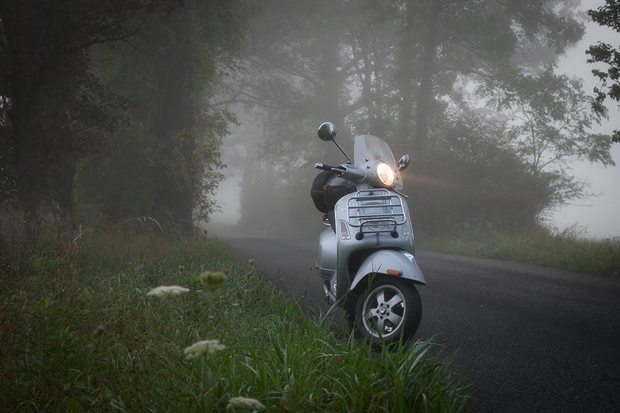 Vespa scooter on foggy road