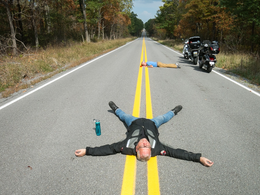 David Masse lying on the road in Sproul State Forest