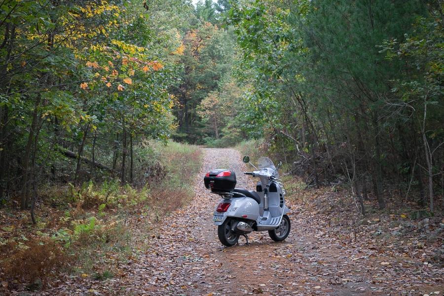Vespa GTS scooter on little gravel road