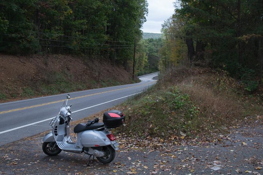 Vespa GTS along winding paved road