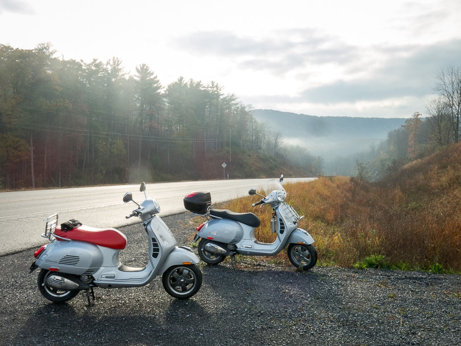 Vespa scooters along a highway