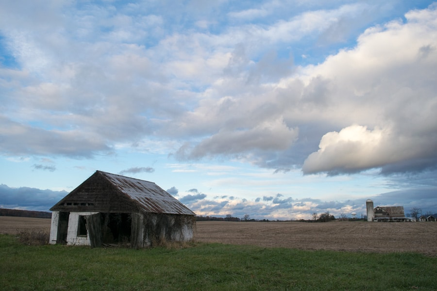 old farm building and cloudy sky
