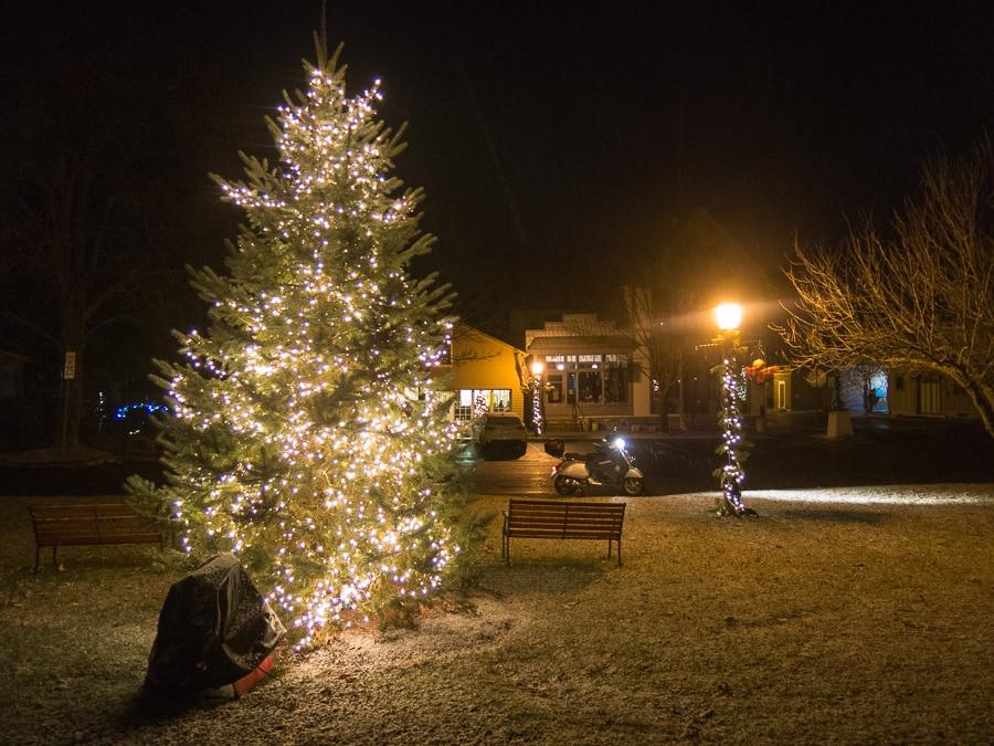 Vespa GTS on snowy night with Christmas tree