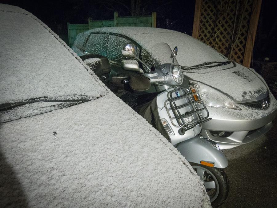 Vespa GTS scooter in snowy night
