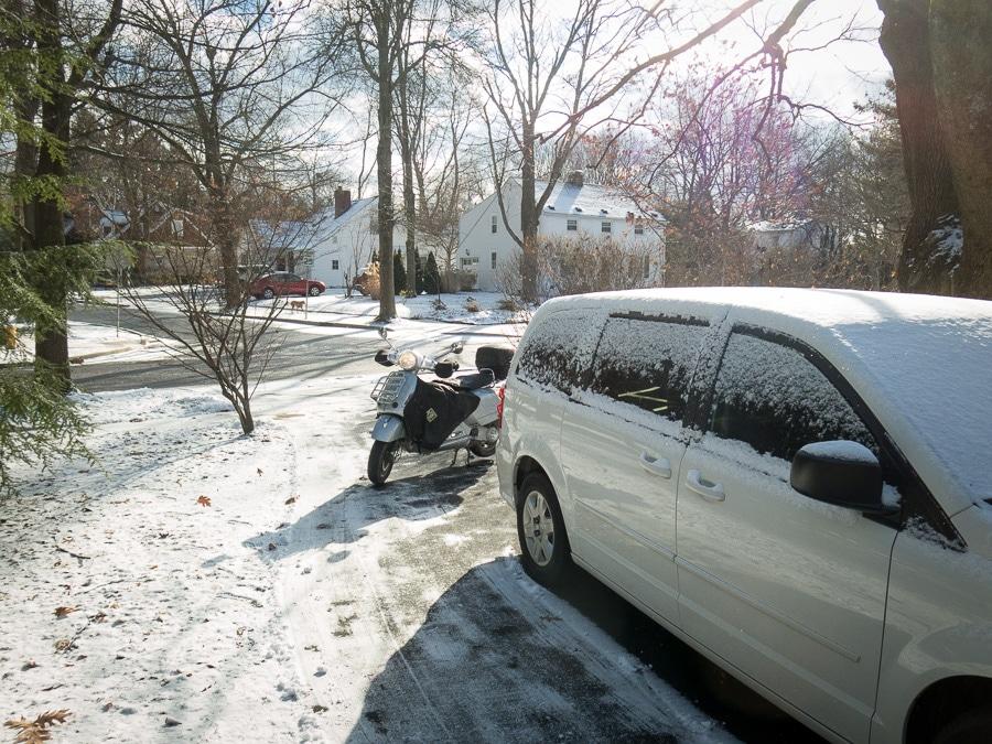 Vespa GTS scooter in a friend's driveway