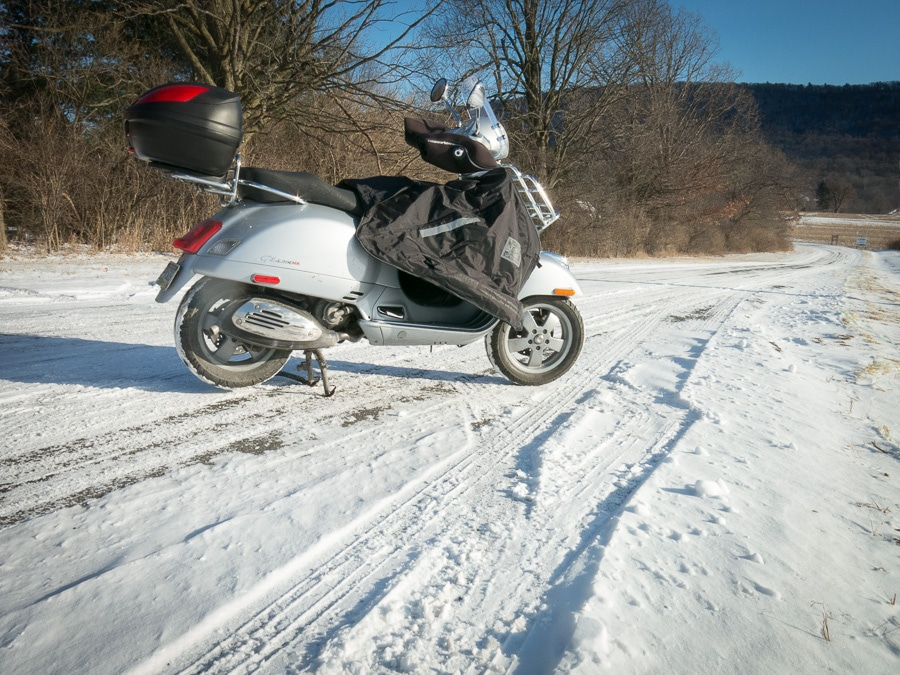 Vespa GTS scooter with Tucano Urbano Termoscud apron in the snow