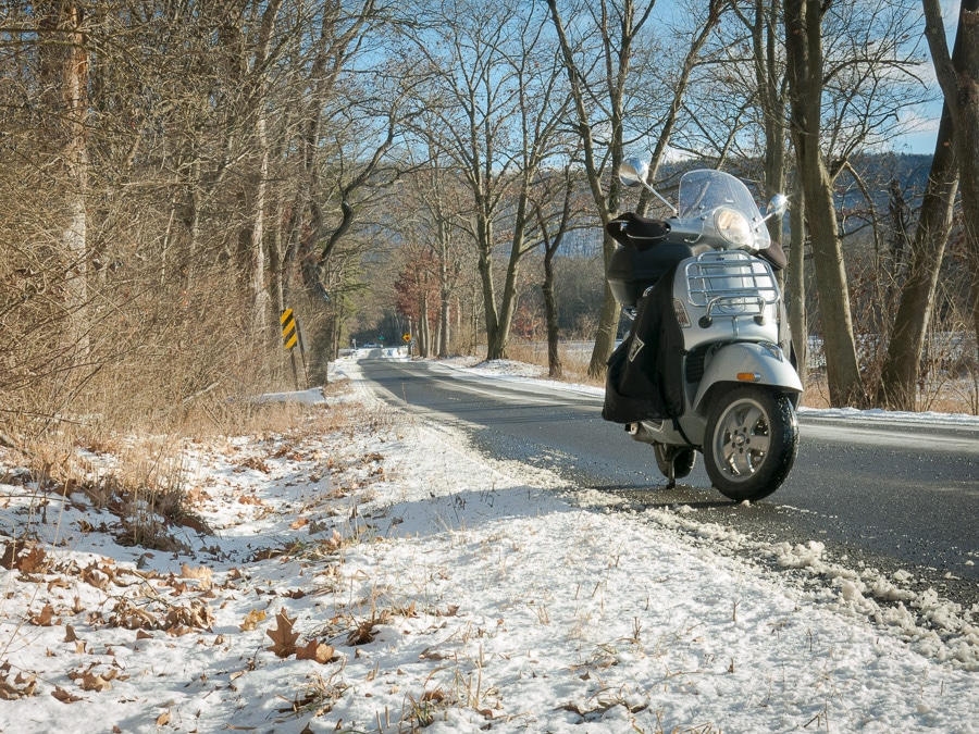 Vespa GTS scooter on winter road