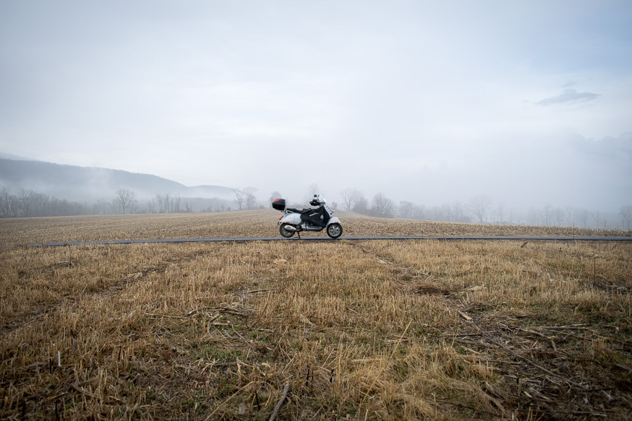 Vespa GTS scooter on an open rural landscape