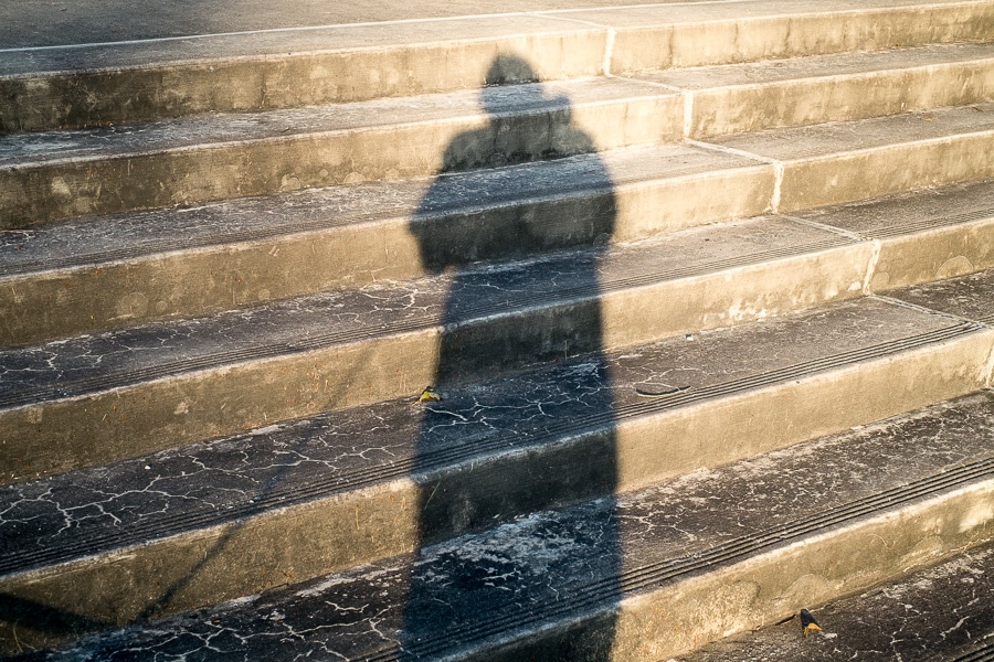 Shadow of photographer on concrete steps