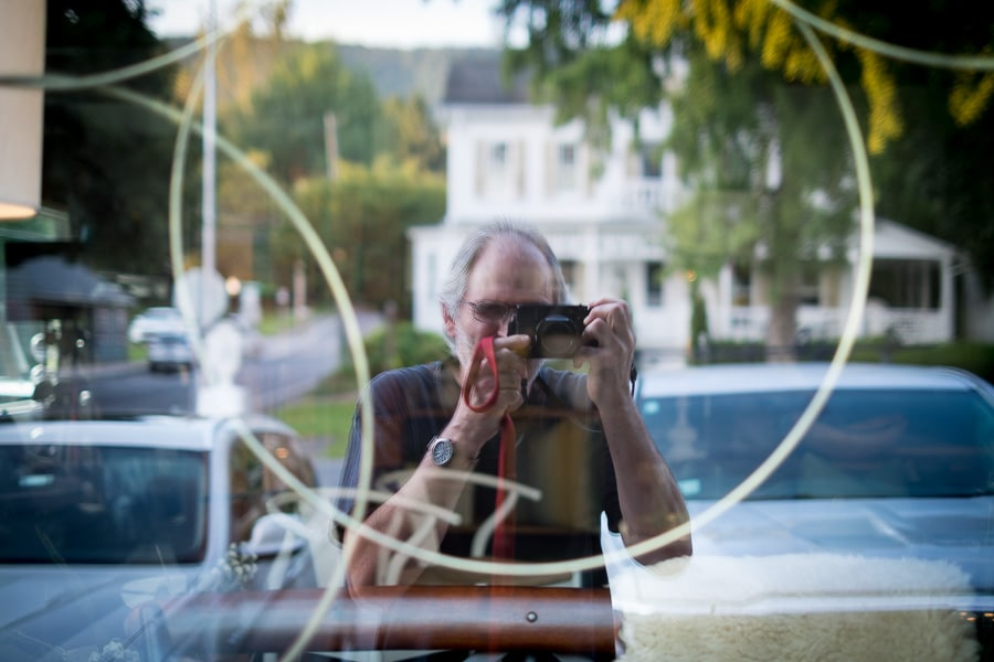 Reflection of photographer in window