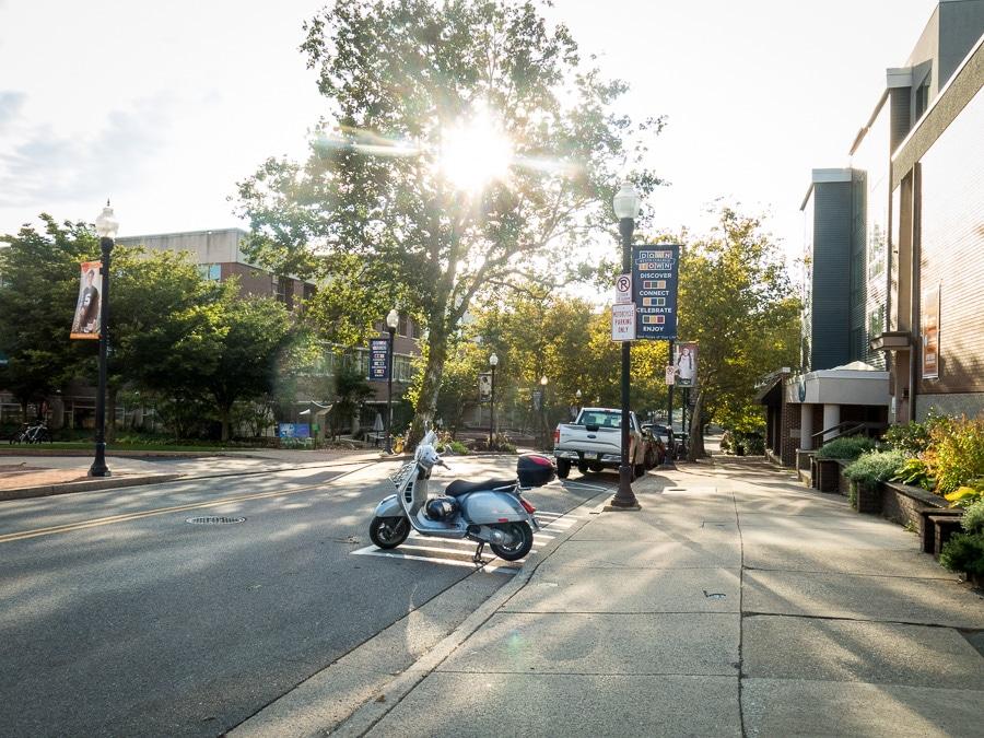Vespa GTS scooter parked on street