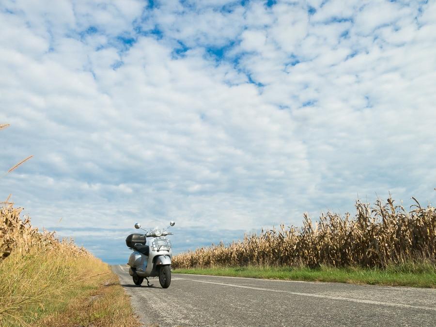 Vespa GTS scooter along rural road